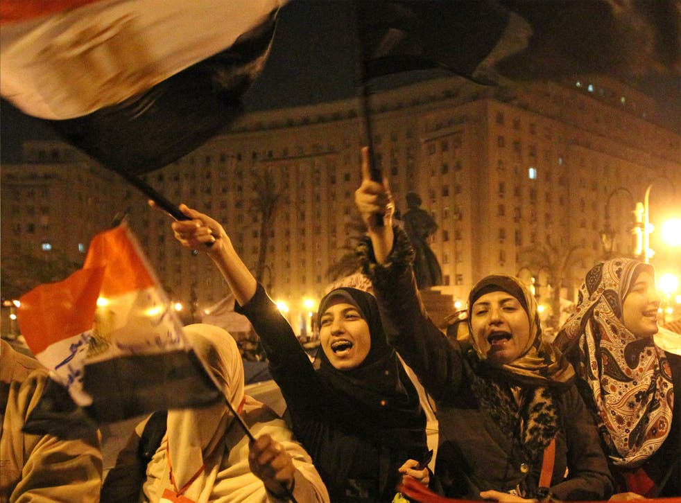 Women celebrate Hosni Mubarak's ceding of power in Cairo's Tahrir Square, in 2011. Nearly half of the protesters calling for the change were women