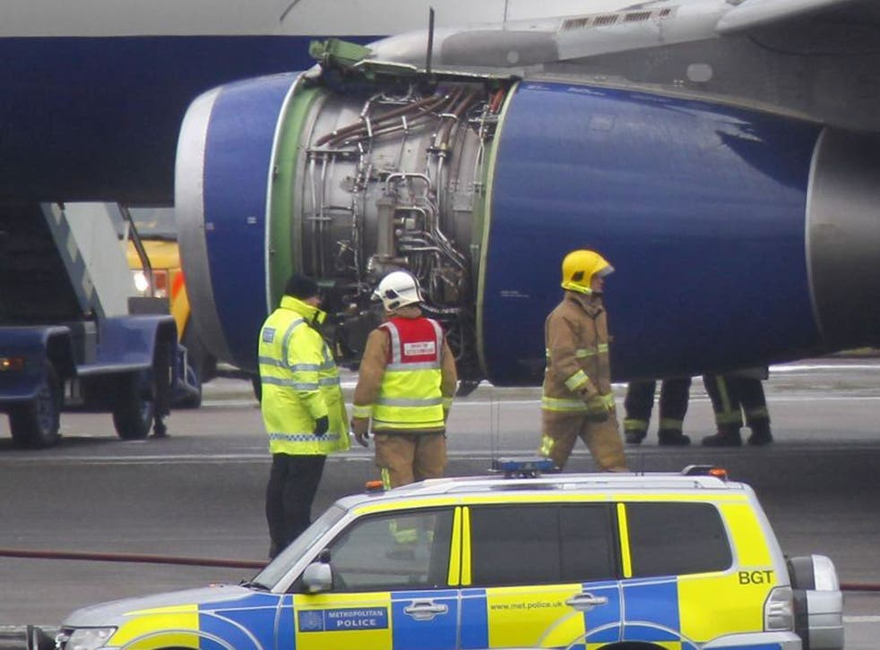A British Airways flight BA762 surrounded by emergency vehicles after an emergency landing at Heathrow airport