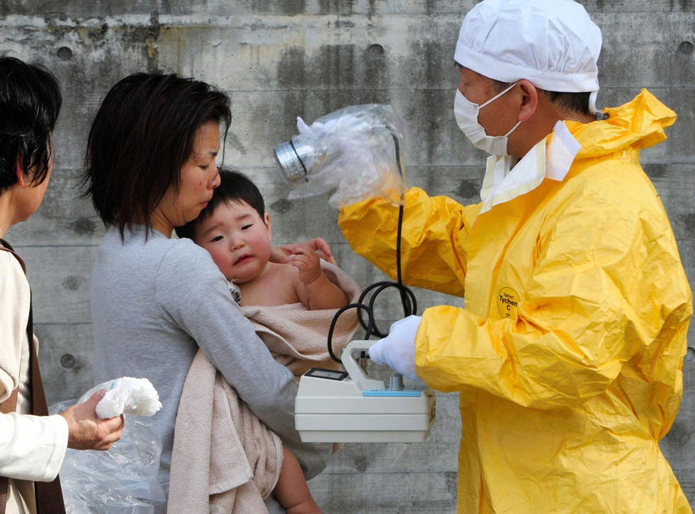 A child is tested for radiation after the accident in March 2011