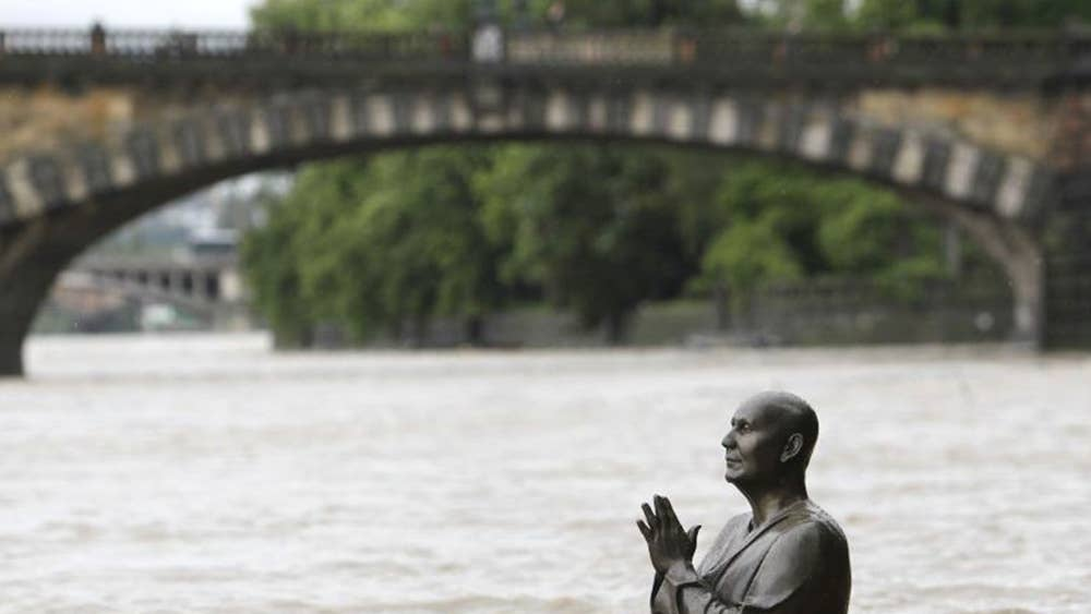 Eight dead as torrential rain sweeps central Europe and leaves