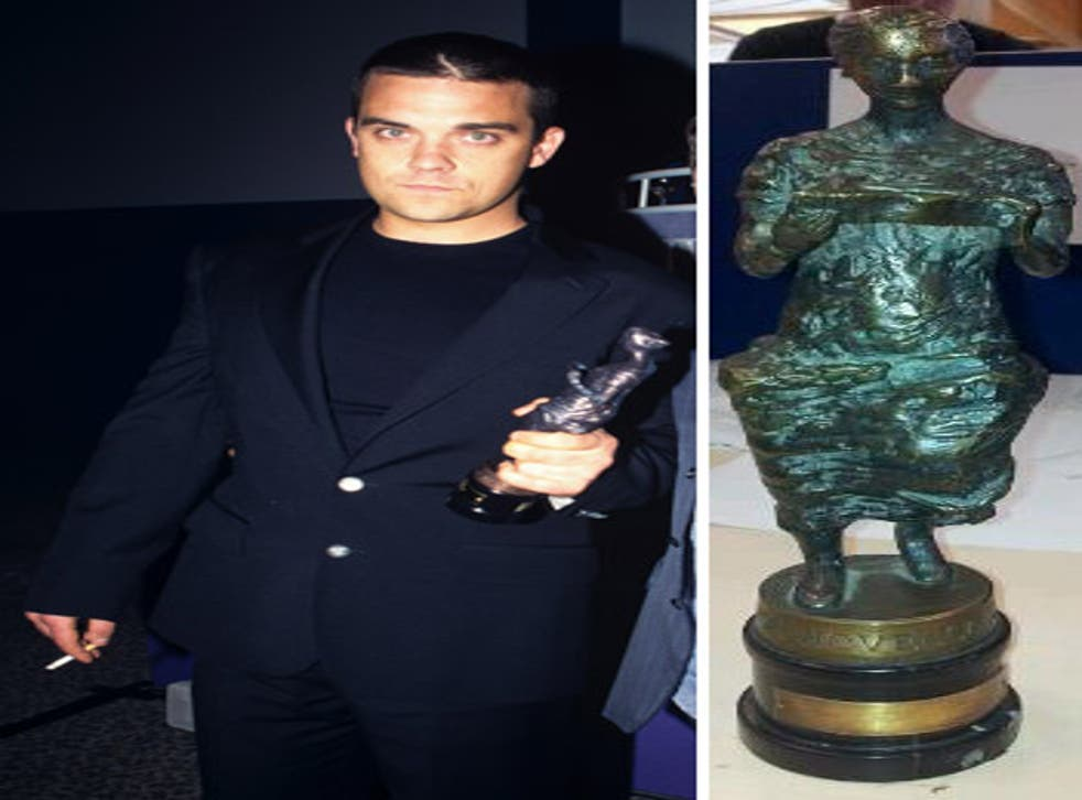 Robbie Williams with his Ivor Novello award in 1990; and the recovered statuette inset