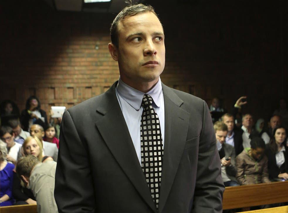 Oscar Pistorius enters the dock at the Pretoria Magistrates court