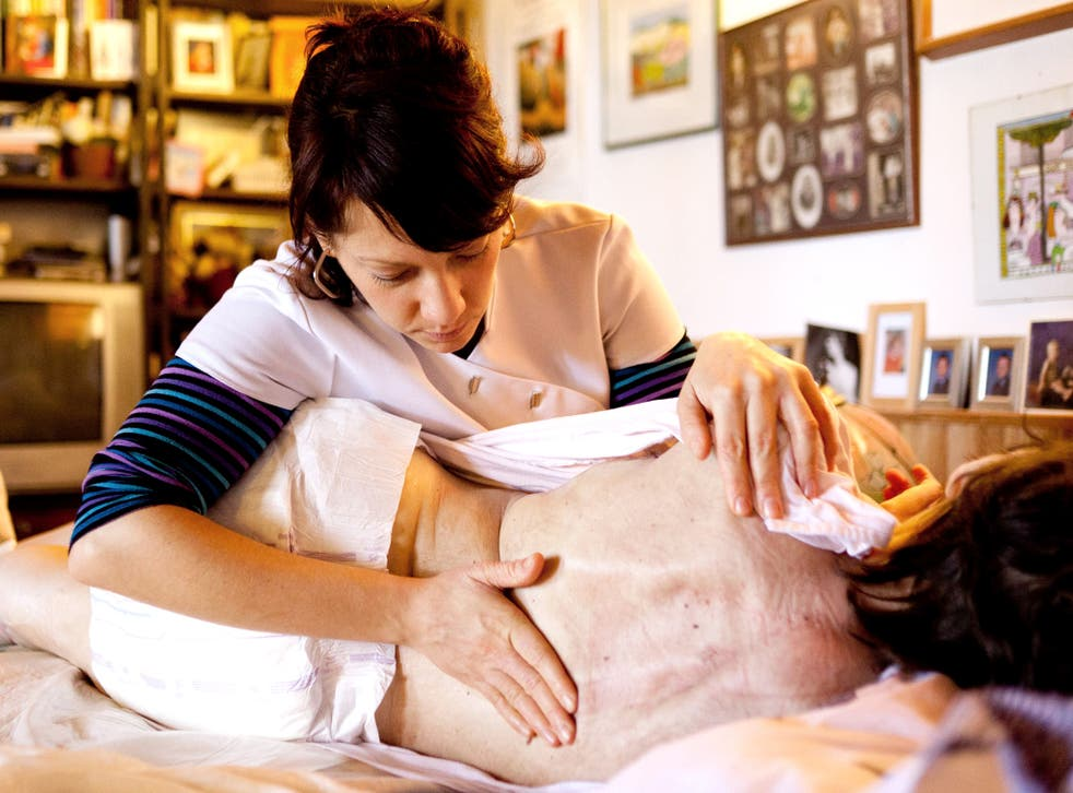 A multiple sclerosis sufferer receiving physiotherapy