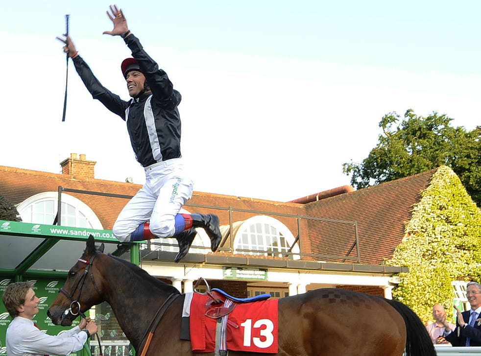 Frankie Dettori dismounts from Asian Trader in trademark style
