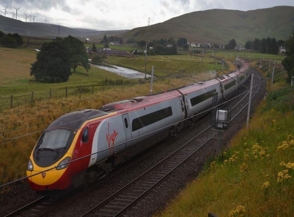 A Virgin train passes along the West Coast mainline route near Abington in Scotland