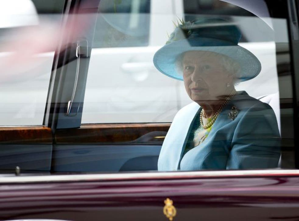 Britain's Queen Elizabeth II sits in her car after officially opening the headquarters of the British Broadcasting Corporation's new Broadcasting House in central London