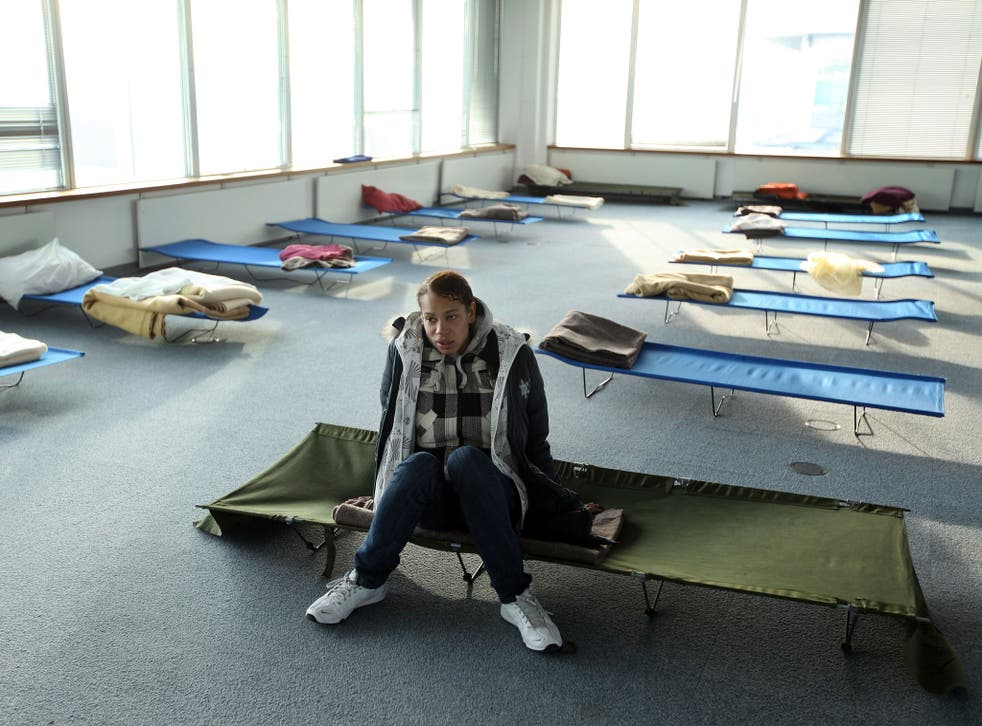 Susan, a homeless woman from London rests on a camp-bed in the dormitory of a Christmas homeless shelter set up by the charity 'Crisis' on December 23, 2009 in London, England.