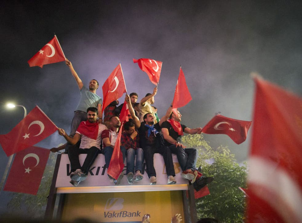 Supporters of Prime Minister Recep Tayyip Erdogan greet his return to Istanbul early yesterday