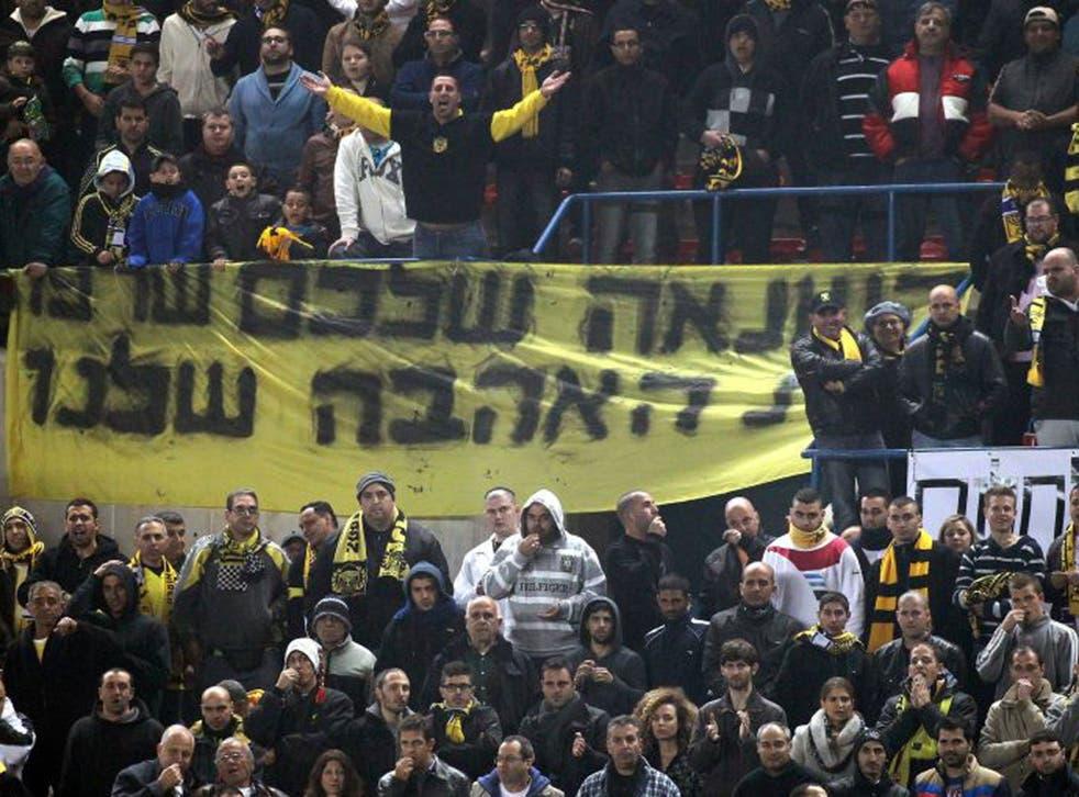 Teddy boys: Defiant Beitar fans' slogan is 'Your hatred burned our love'