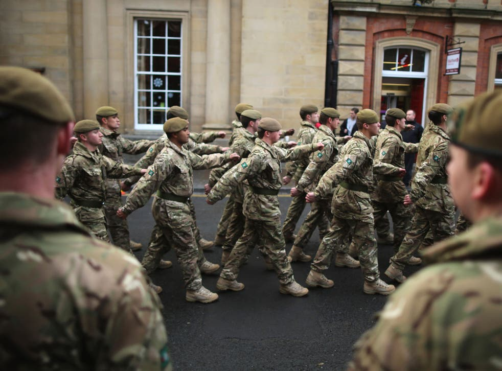 Soldiers from 3rd Battalion The Yorkshire Regiment march through the streets of York during a homecoming parade on December 5, 2012 in York, England.