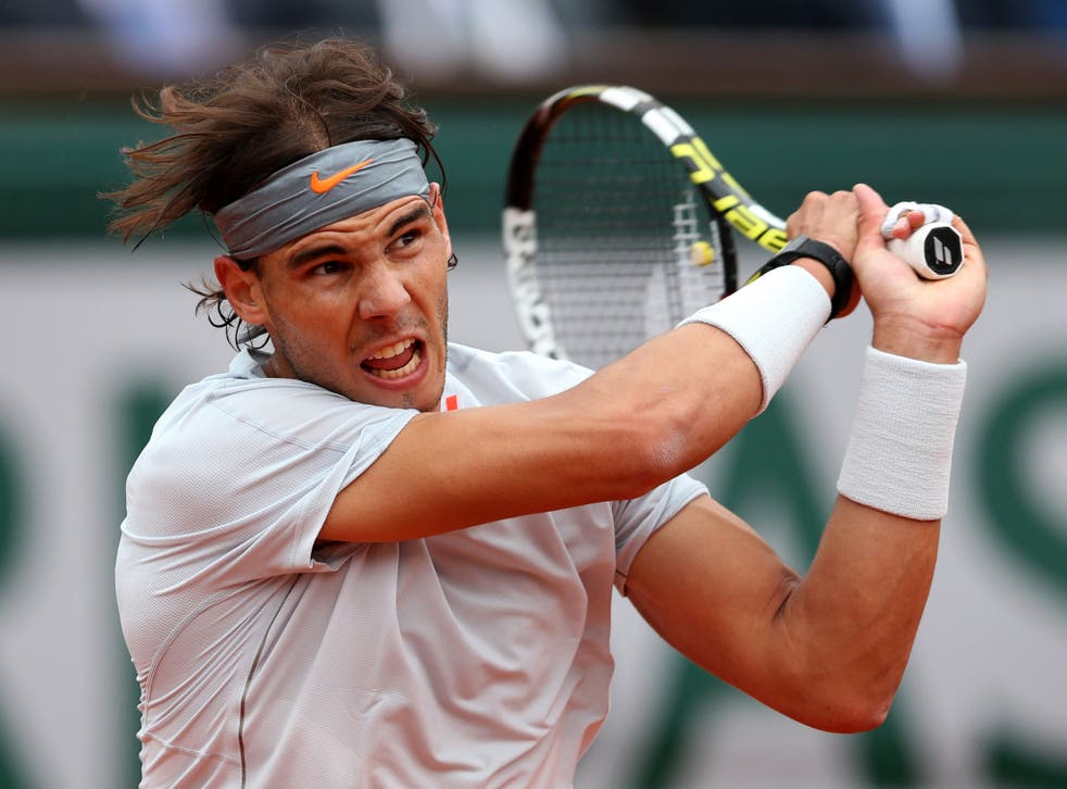 Rafael Nadal of Spain plays a backhand during the Men's Singles final match against David Ferrer