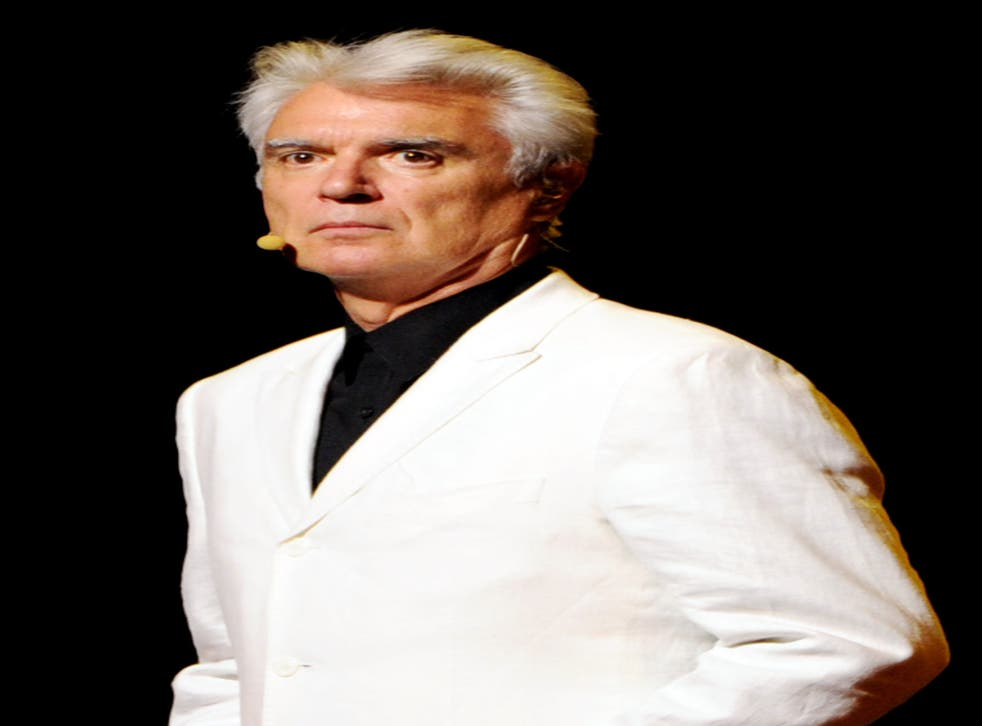 David Byrne took to the stage at Columbia University School of the Arts as a band played his song 'Road to Nowhere'. He then played a slideshow of graphs to illustrate how hopeless arts graduates are