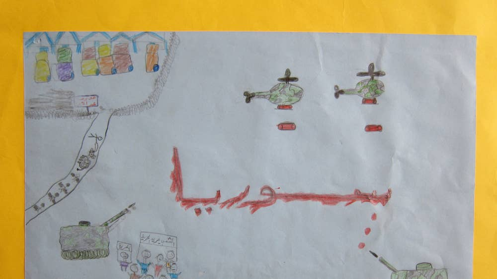 Through Their Eyes Children Who Fled The Violence Draw Picture Of