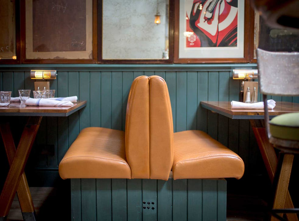 Artfully designed: The Fish & Chip Shop features grey tables, blue wood panels and 1940s furniture