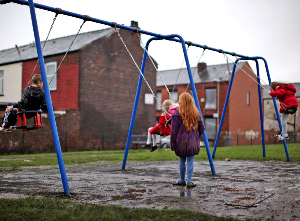 Children living below the poverty line are now twice as likely to come from working families struggling on low incomes and falling wages than those whose parents are unemployed, official figures have revealed