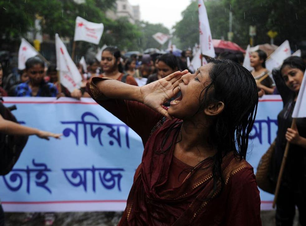Students supporting various Leftist parties shout anti-government slogans during a protest following the recent gangrape and murder of a 20-year-old college student in Barasat, in Kolkata
