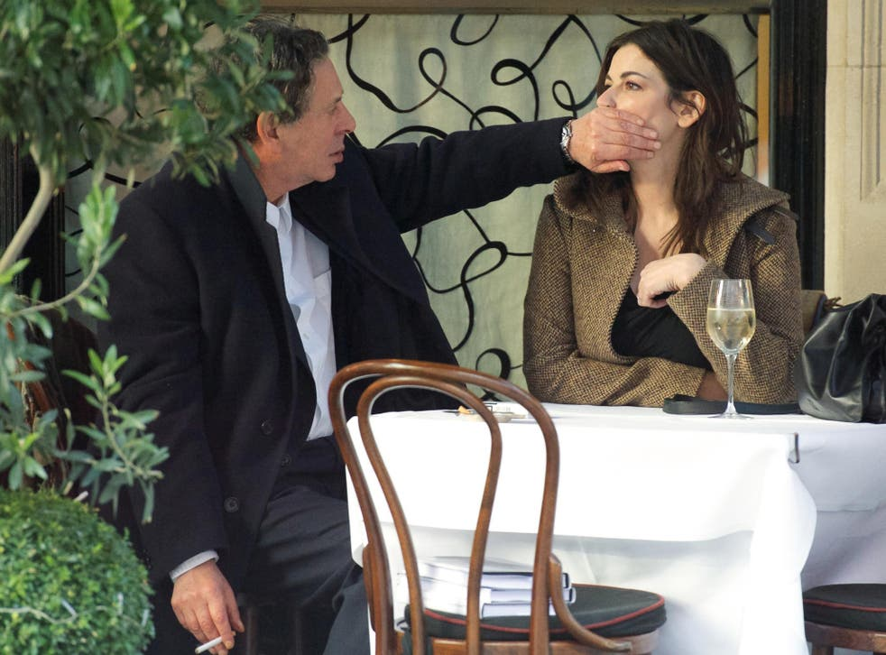 Charles Saatchi puts his hand over Nigella Lawson's mouth at Scott's in December