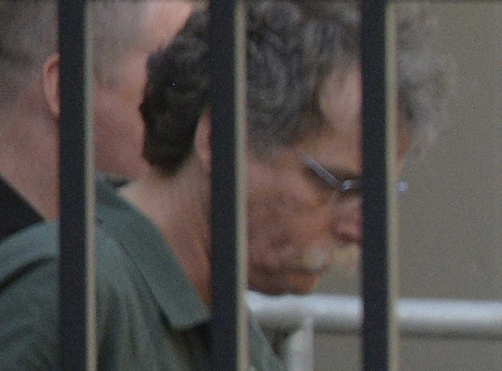 Eric J Feight leaves the federal courthouse in shackles
