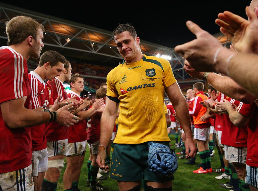 James Horwill is clapped off the field by the victorious Lions players
