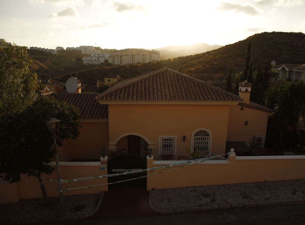 House sealed off by the Spanish civil guard where three members of a British family were found dead inside in Mijas Costa