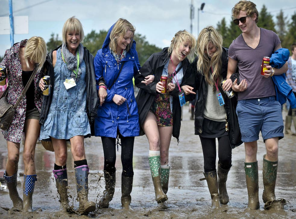 Friends from Torquay splash in the mud at the Glastonbury 2011
