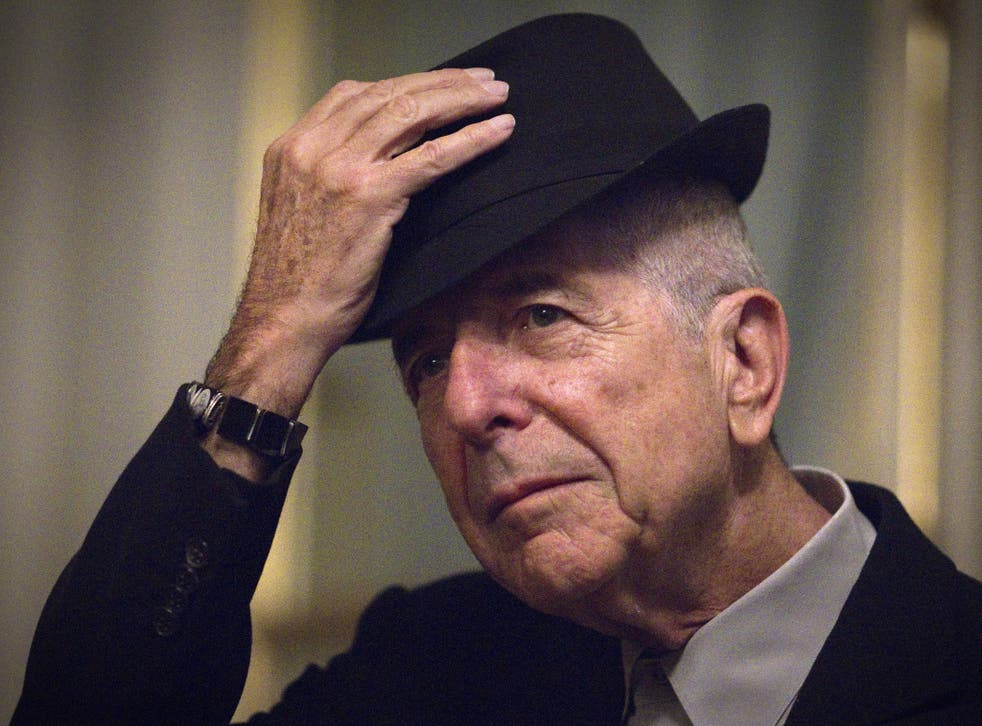 Canadian singer and poet Leonard Cohen takes off his hat to salute on January 16, 2012 in Paris.