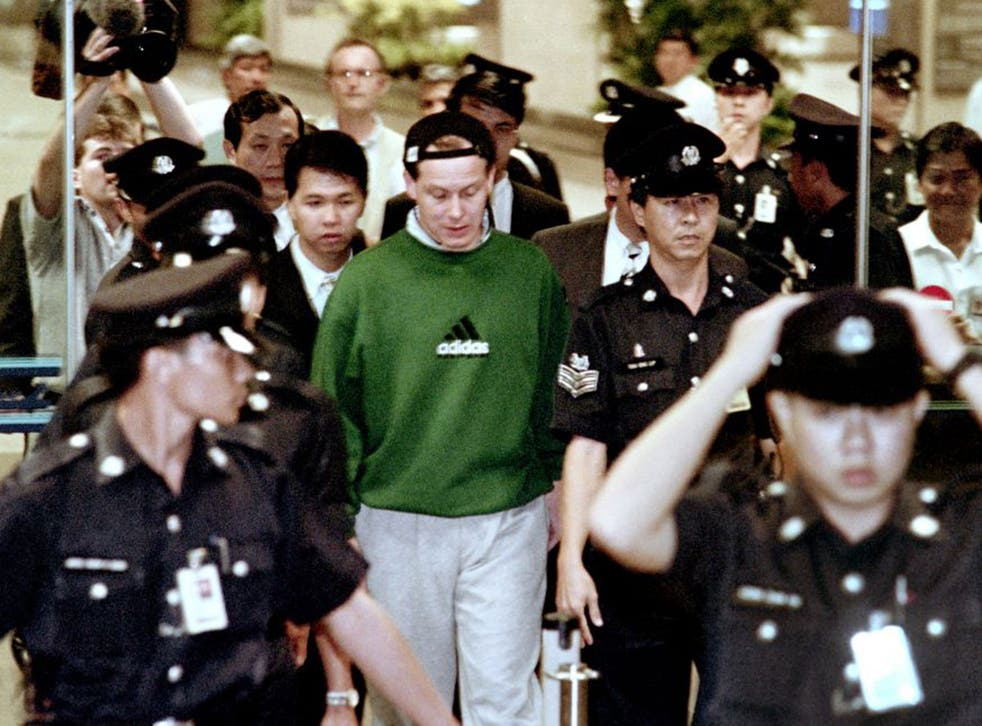 Nick Leeson arrives back at Changi airport in November 1995 after being extradited from Germany