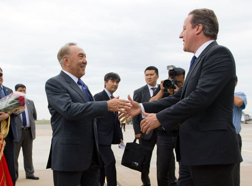 David Cameron is greeted by President Nursultan Nazarbayev after landing at Atyrau airport