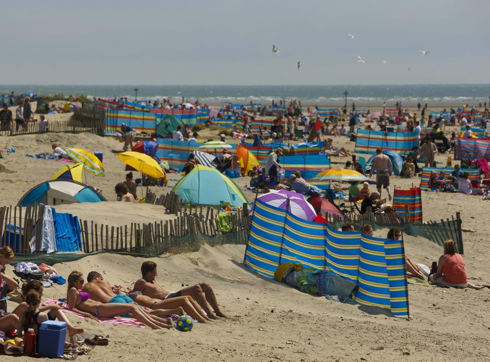 Day-trippers enjoying the sun on West Wittering beach near Chichester, West Sussex