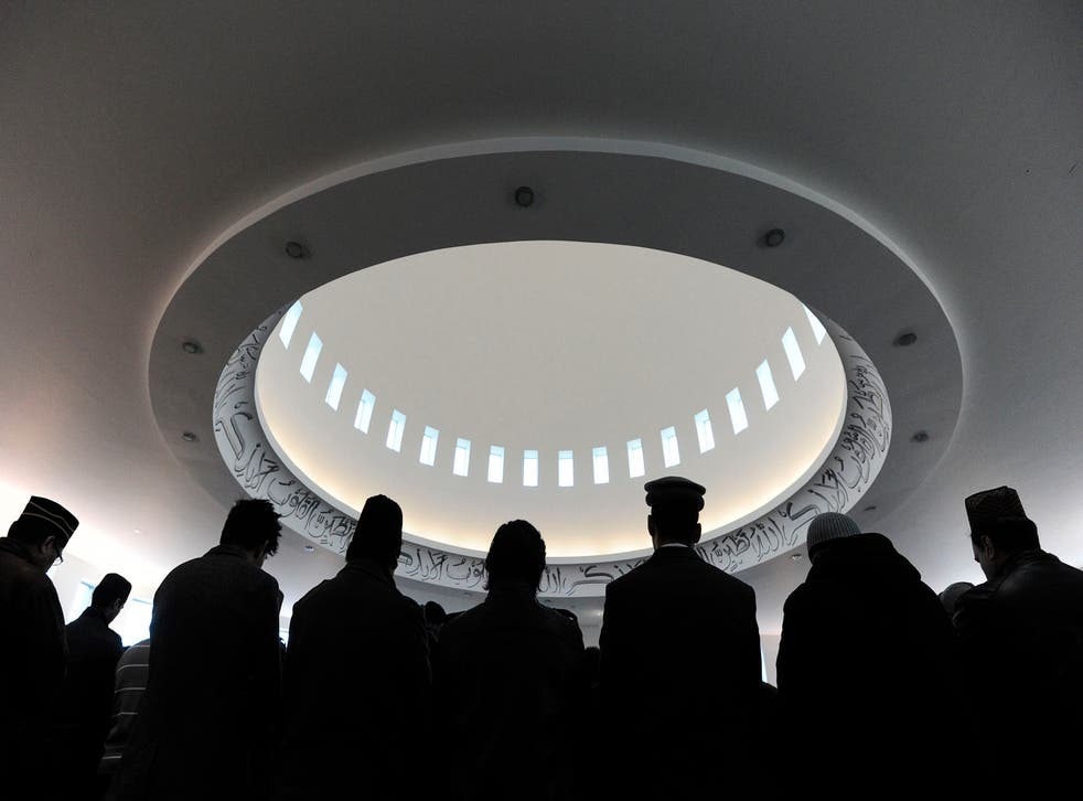 Muslims stand in the prayer hall during Friday prayers in Baitul Futuh Mosque in south London. Channel 4 will broadcast the call to prayer live during Ramadan.