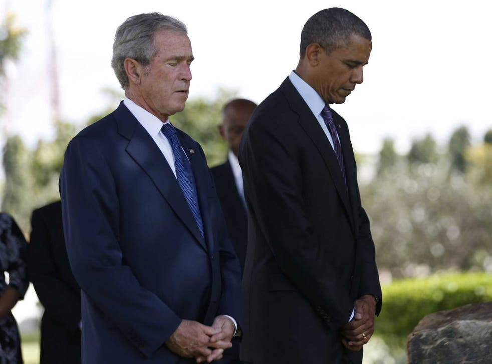 Barack Obama and George W Bush attend a memorial for the victims of the 1998 US Embassy bombing in Dar es Salaam