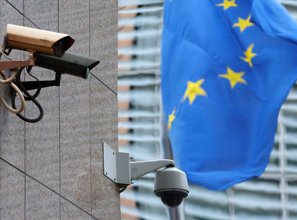 Security cameras are seen near the main entrance of the European Union Council building in Brussels July 1, 2013. The European Union said on Monday it had ordered a security sweep of EU buildings after reports that a U.S. spy agency had bugged EU offices