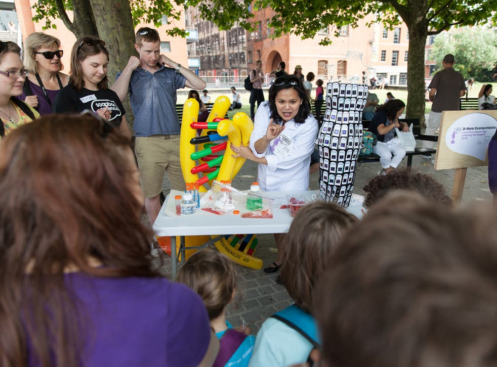 One of the scientists climbs off her soapbox to give a demonstration