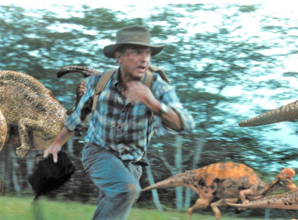 Sam Neill runs away from dinosaurs in Jurassic Park III