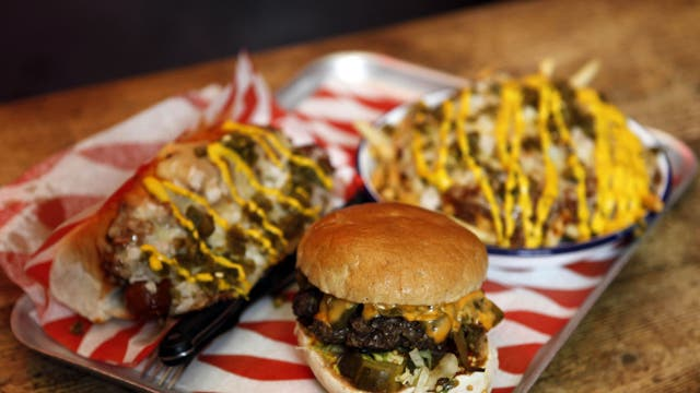 The 'Triple Chilli Challenge' involves a plate of chilli cheese fries, a chilli dog, and a green chilli burger