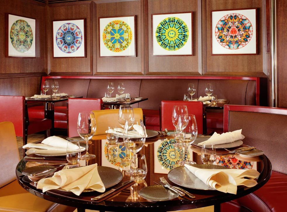 """All 16 of Damien Hirst's limited edition Diamond Dust """"Psalms"""" series hang in the restaurant"""