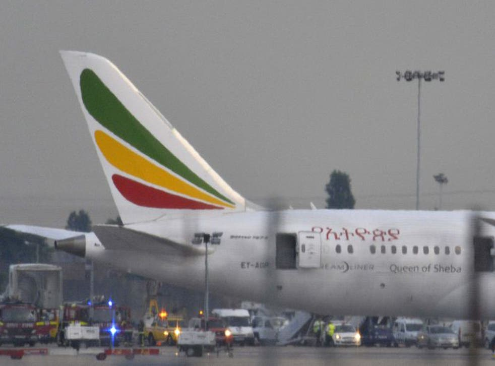 Emergency services attend to a Boeing 787 Dreamliner, operated by Ethiopian Airlines, after it caught fire at Heathrow airport
