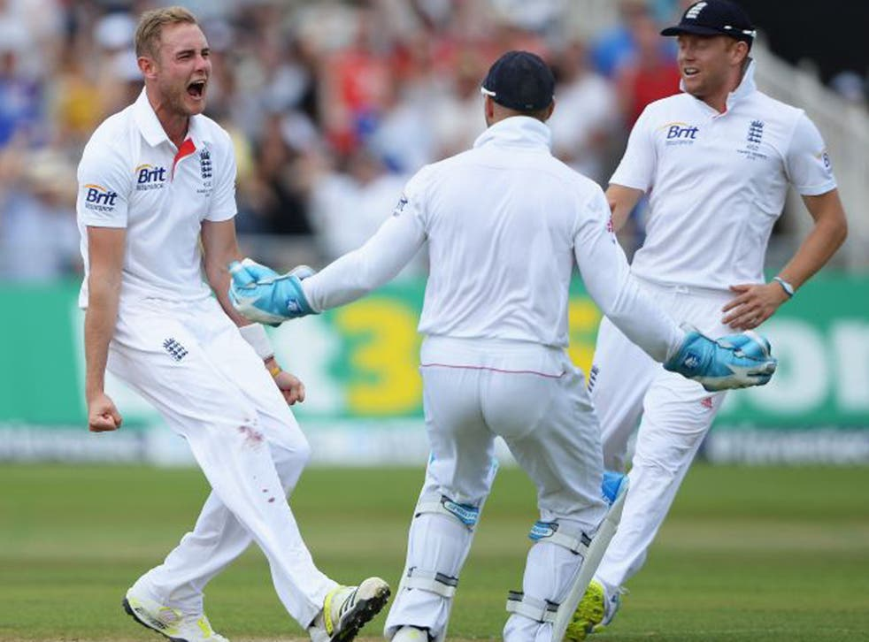 Stuart Broad celebrates the wicket of Australia's Shane Watson to get England on the board after an opening stand of 84 (Gareth Copley/Getty Images)