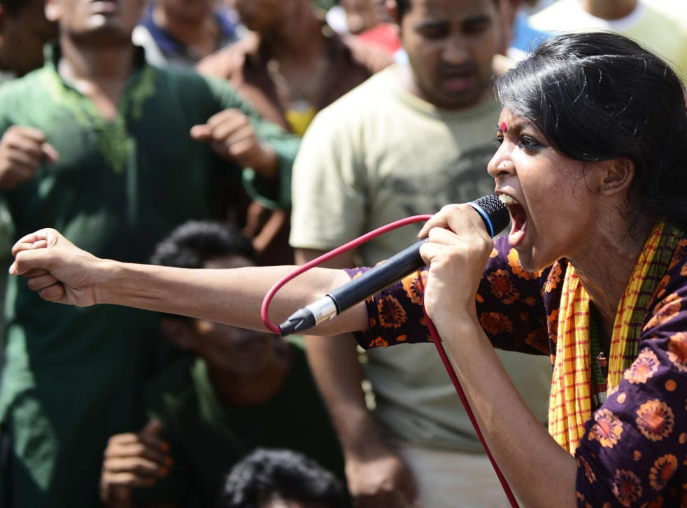 A Bangladeshi social activist shouts slogans against Ghulam Azam, whom she and other protesters wished to be sentenced to death, outside a court in Dhaka
