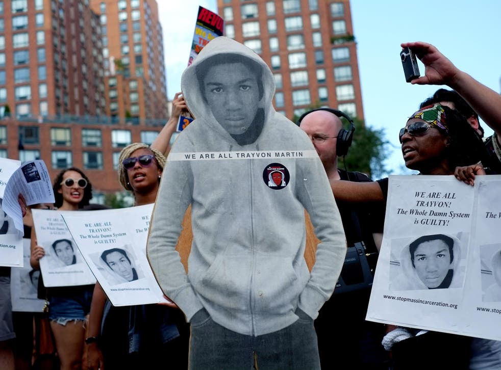 Activists on Union Square stand with a cut out photo of Trayvon Martin in New York