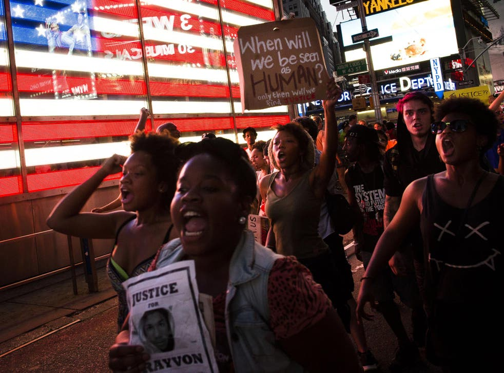 Demonstrators enter Times Square in New York, during a march against the acquittal of neighborhood watch member George Zimmerman in the killing of 17-year-old Trayvon Martin in Florida