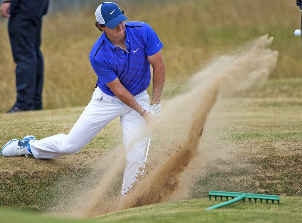 Rory McIlroy pops out of the bunker during practice