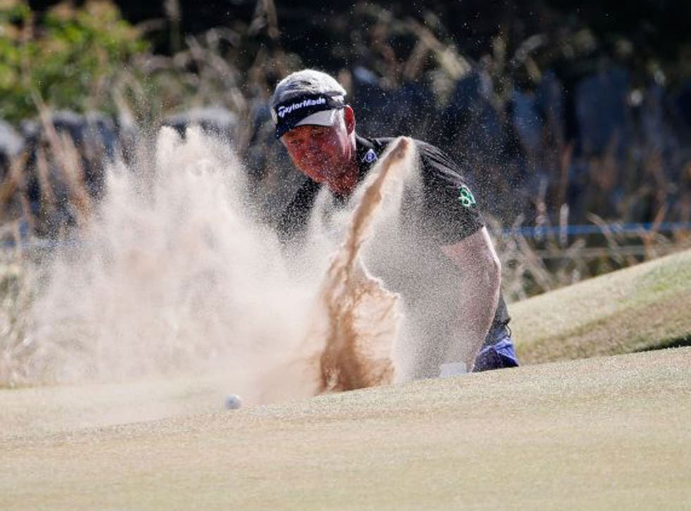 Darren Clarke thrashes around in the bunker on the sixth on his way to a quadruple bogey eight