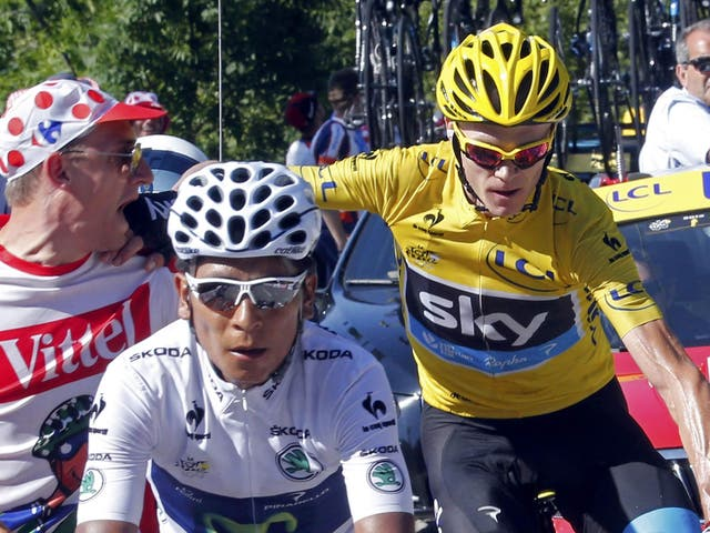 Shove off: Froome (yellow jersey) gives a spectator short shrift as he comes in behind stage winner Quintana