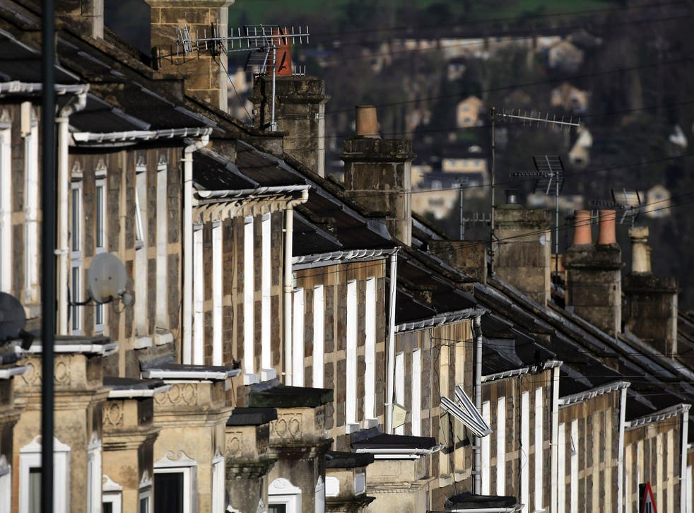 The winter sun illuminates houses in a residential street on January 2, 2012 in Bath, England.