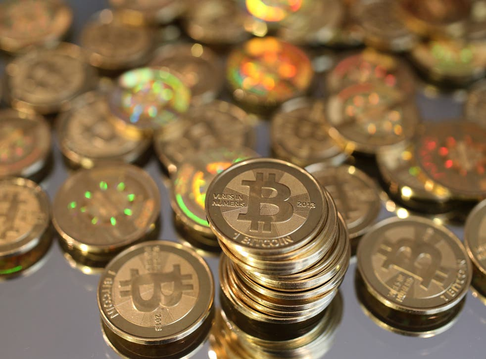 A pile of Bitcoins are shown here after Software engineer Mike Caldwell minted them in his shop on April 26, 2013 in Sandy, Utah. Bitcoin is an experimental digital currency used over the Internet that is gaining in popularity worldwide. (Photo by George