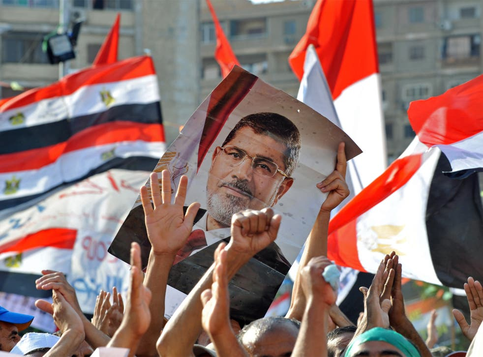Mohamed Morsi supporters continue to hold a sit in outside Cairo's Rabaa al-Adawiya mosque