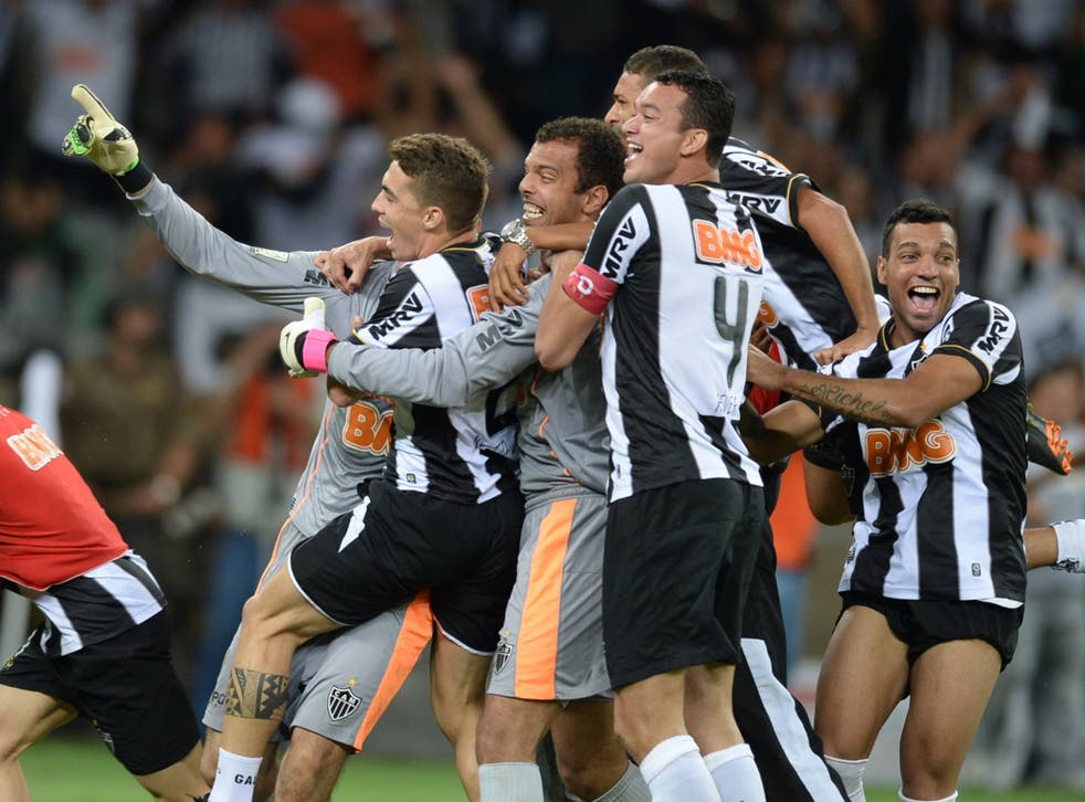 Atletico Mineiro's players celebrate after winning the Libertadores Cup