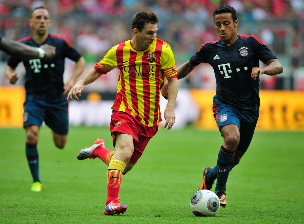 Lionel Messi in action against Bayern Munich's Thiago Alcantara