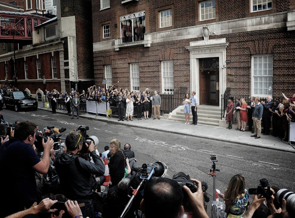 First photo-op: Prince George makes his debut before the world's media last Tuesday